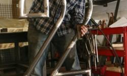 Майкл Пул и одна из его цифр от велопарковки